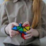 girl showing bright brainteaser in hands