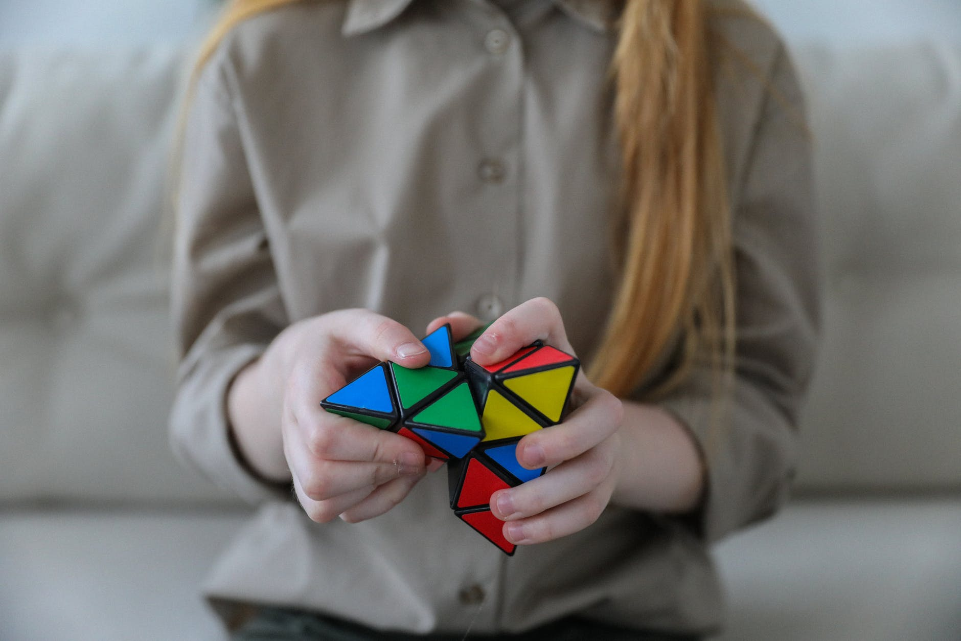 girl showing bright brainteaser in hands
